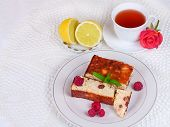 Cheese casserole with raisins and lemon on plate over white napkin