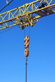 Yellow Industrial Crane Isolated On Blue Sky