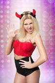 female go go dancer.  girl wearing devil horns