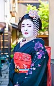 KYOTO,JAPAN-OCT 24,2014:Unidentified geisha on Oct 24,2014 , Kyoto,Japan. Apprentice geisha in western Japan, especially Kyoto.Their jobs consist of performing songs, dances, and playing the shamisen.