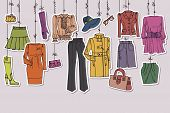 Постер, плакат: Womans clothing and accessories hanging on ropes
