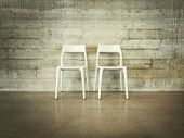 White Chairs Near Concrete Wall