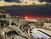 Roman Amphitheatre In The City Of El Jem In Tunisia Amid Colorfull Sunset