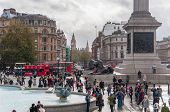 Tourists Visit Trafalgar Square In London On A Cloudy Day