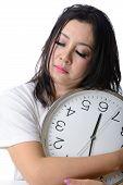 Sleepy Asian Woman Hug The Clock.
