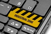Industrial Zone. Yellow Warning Key On Computer Keyboard