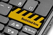Restricted Area. Yellow Warning Key On Computer Keyboard