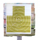 foto of shooting-range  - Military shooting target with bullet holes on white background - JPG