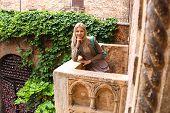 Attractive Girl Is Standing On The Balcony Of Juliet In Verona, Italy