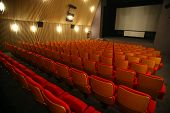 image of cinema auditorium  - Color horizontal shot of some seats in a cinema hall - JPG