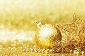 Shiny Golden christmas decor over glitter background