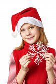 Beautiful Girl In Red Santa Hat With Snowflake