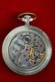 Metallic Round Watch With Opened Mechanism