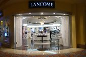 A Shopkeeper Walks In The Lancôme Boutique In Macau