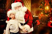 Portrait of Santa Claus with a boy standing at home decorated for Christmas. Christmas scene.