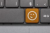 Smile. Orange Hot Key Emoticon On Computer Keyboard.