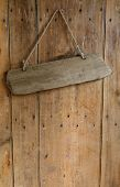 Blank Sign Hanging From A Nail On An Old Rustic Wooden Oak Weathered Front Door.
