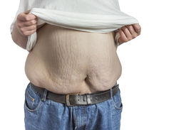 picture of bulging belly  - overweight Man in blue jeans lifting his white t - JPG