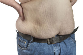 foto of bulging belly  - Shirtless overweight Man in blue jeans with hands on his hips isolated on white background - JPG