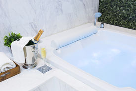 picture of champagne color  - Champagne glass and Jacuzzi Spa with colourful light whirlpool - JPG