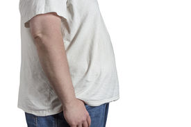 stock photo of bulging belly  - overweight Man in blue jeans and white t - JPG