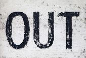 picture of won  - The word OUT etched on a won and textured wall - JPG
