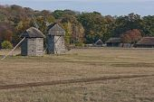 Autumnal Country Scenery. Two Windmills In The Field.