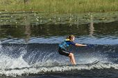 stock photo of ski boat  - Young teen girl learns to water - JPG