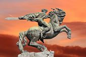 image of horse-riders  - Bronze sculpture of a rider and his war horse in a rapid burst - JPG