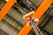stock photo of pulley  - Crane pulley under the shade of manufacturing unit - JPG