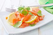picture of redfish  - salad on salmon on the white plate - JPG