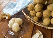stock photo of lanzones  - longkong sweet fruit Peeled placed in a bowl - JPG