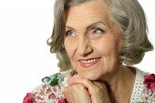 foto of elderly  - Portrait of a thinking elderly woman  on white background - JPG
