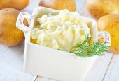 pic of mashed potatoes  - mashed potato in bowl and on a table - JPG