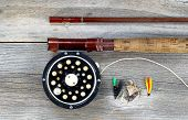 foto of trout fishing  - Antique fly fishing reel and rod on rustic wood - JPG