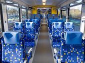 stock photo of passenger train  - Interior of an empty passenger train car with two rows of seats - JPG
