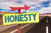 stock photo of honesty  - Honesty sign with road background - JPG