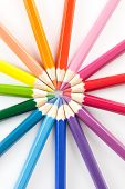 picture of color wheel  - Color pencils arranged in a color wheel on a white background - JPG