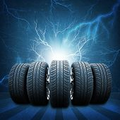 foto of lightning  - Five of new car wheels - JPG