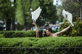 pic of undressing  - beautiful couple undress in a European city - JPG