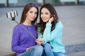 picture of two women taking cell phone  - Beautiful girls - JPG