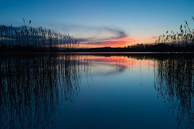 stock photo of landscapes beautiful  - Beautiful sunset over calm lake - JPG