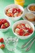 stock photo of quinoa  - healthy breakfast quinoa with strawberry banana coconut flakes - JPG