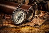 Постер, плакат: Travel geography navigation concept background old vintage retro compass with sundial spyglass an