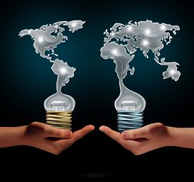 picture of creativity  - Global creativity business success concept as people holding ligh t bulbs shaped as world continents as a financial trade symbol for creative collaboration and exchange of innovation - JPG