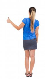 stock photo of up-skirt  - Back view of  woman thumbs up - JPG
