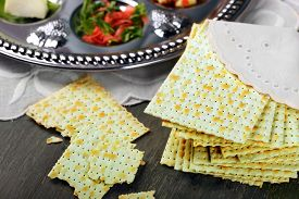 foto of seder  - Matzo for Passover with Seder meal on plate on table close up - JPG