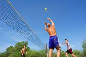 People Playing Beach Volleyball - Balding Man Passes The Ball For Spike