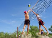 Men Playing Beach Volleyball - Teen In Red Hat Misses Ball From Tall Guy
