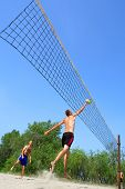 People Playing Beach Volleyball - Tall Man Hits The Ball In Jump